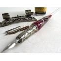 En bladsilver glas kalligrafi penna som med penna vila