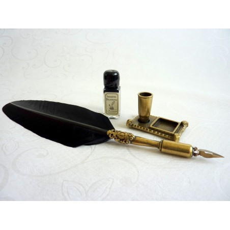 Black feather, pewter quill and stand