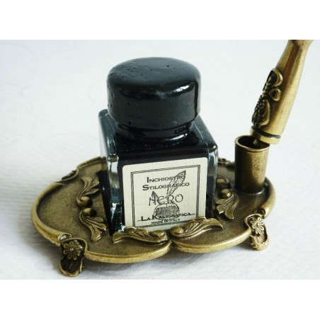 Brown feather and pewter quill with ink bottle and pen holder