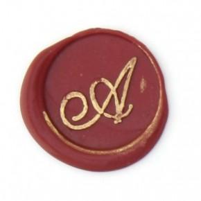 Kursive initialer i bronze