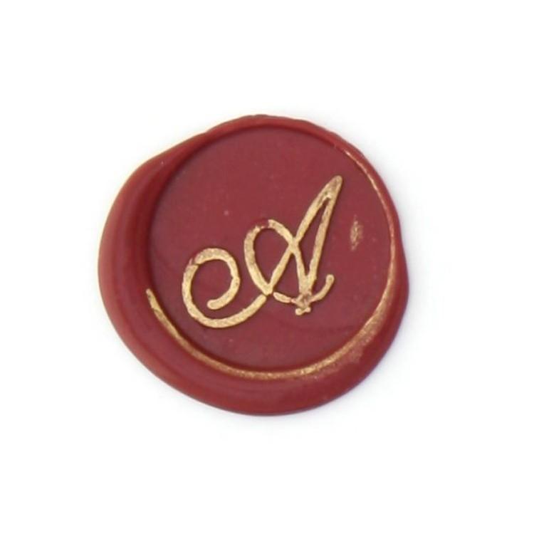 Cursive bronze initial letter