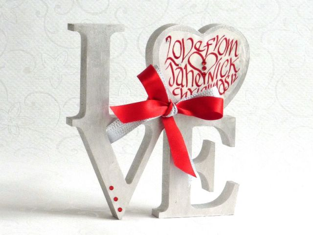 A Gift of Love calligraphy figure